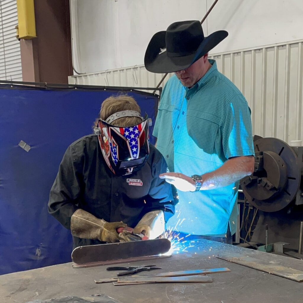young student welder learns how to weld
